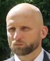 E. Sneiders